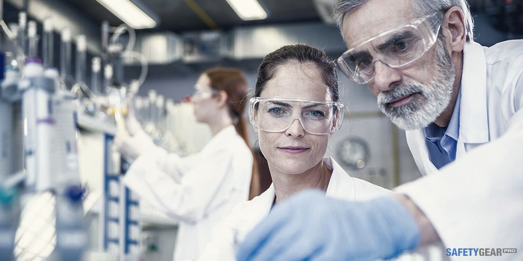 workers wearing safety glasses in laboratory