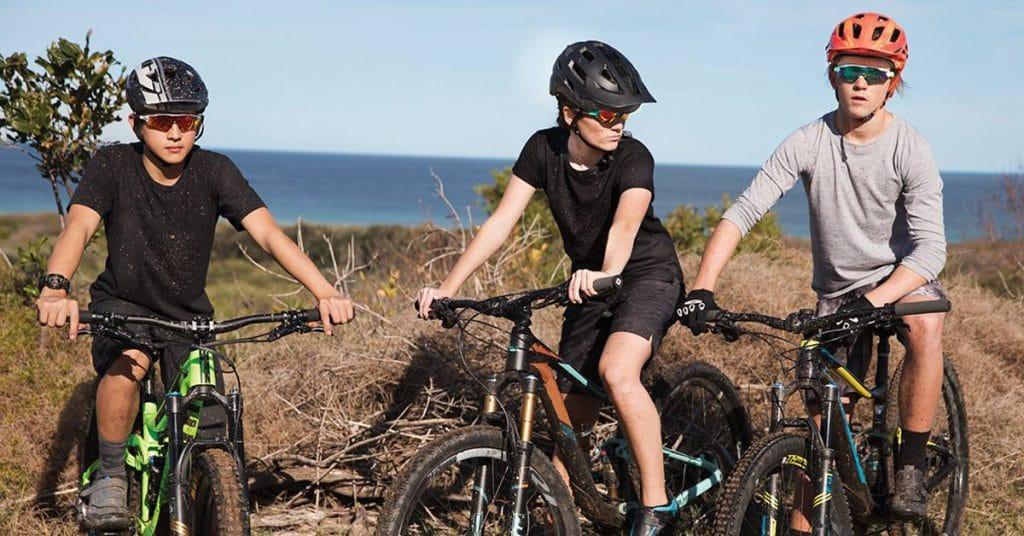 Boys on bikes wearing Oakleys