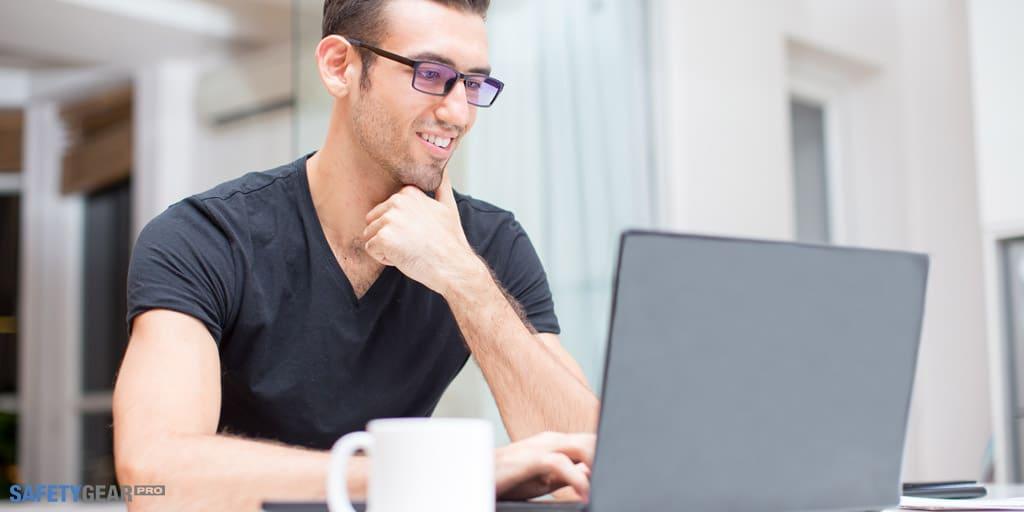 man wearing eyeglasses on his laptop