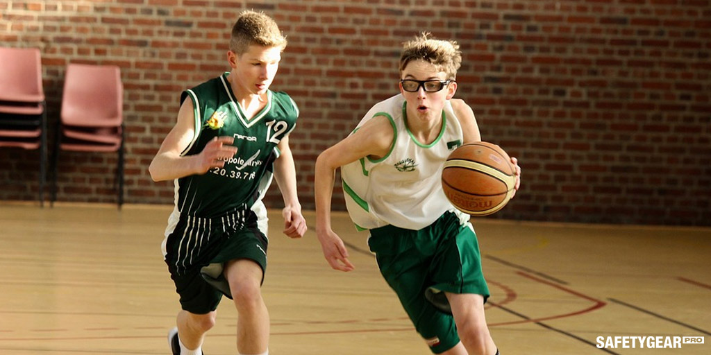 two kids playing basketball wearing glasses