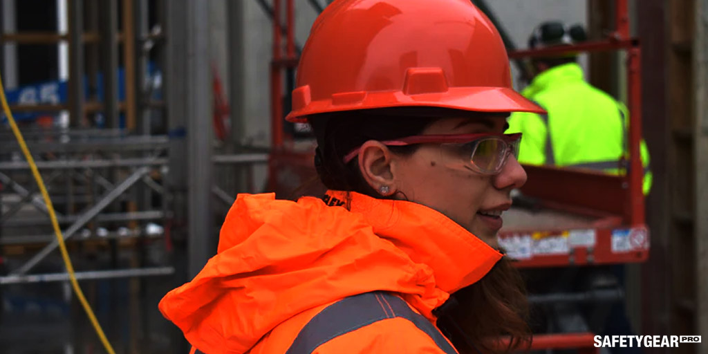 woman wearing hard hat and glasses