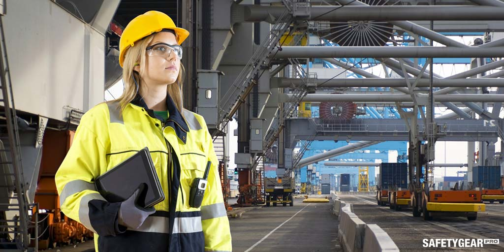 Woman wearing hardhat and safety vest
