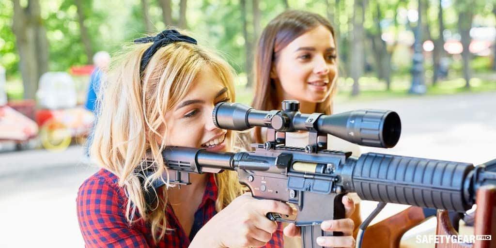 Woman using shooting gun
