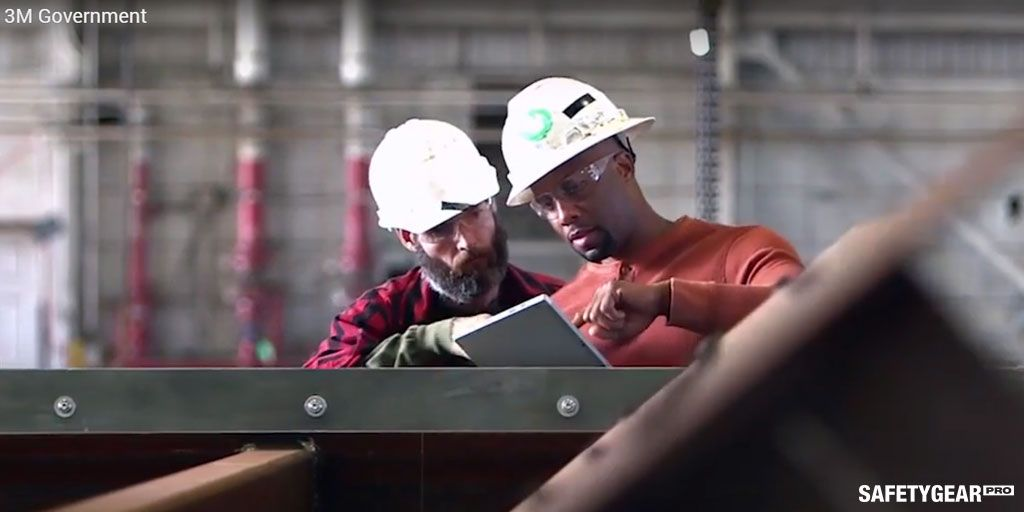 men wearing 3M safety glasses while working