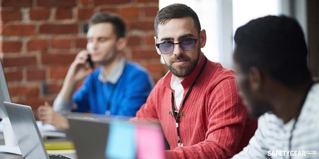 Man wearing blue light computer glasses
