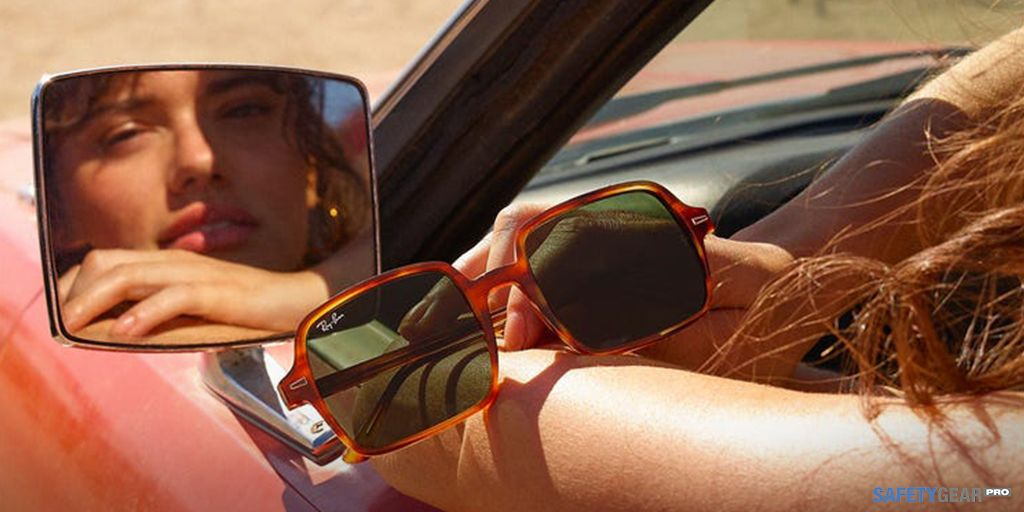 woman in a car holding Ray-Ban Sunglasses
