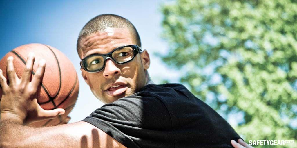 man wearing basketball glasses while playing